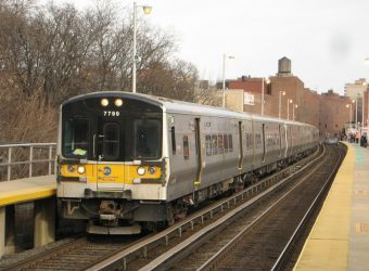 LIRR Port Washington Branch train, led by M7 #7799, enters the Flushing station.